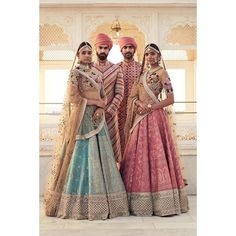 Bridal Wear - Sabyasachi Pink and Blue Bridal Lehengas with Gold Dull Embroidery and Tranluscent Floral Blouses | WedMeGood | Grooms in Striped Pink Sherwanis with Pink Safa #wedmegood #indianbride #indiangroom #indianwedding #sabyasachi #pink #lehenga #sherwani #safa #blue #coupleshot #floral #translucent