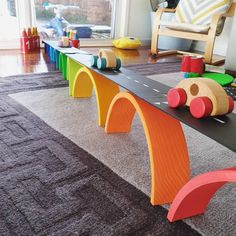 I saw this creation a while ago and I bookmarked it because I was itching to build it. This uses the Grimms large rainbow and building… Montessori Playroom, Montessori Activities, Infant Activities, Activities For Kids, Grimm's Toys, Kids Toys, Grimms Rainbow, Playroom Decor, Playroom Furniture