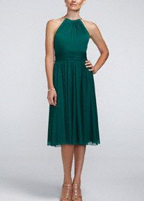 Let your inner goddess shine through in this absolutely gorgeous halter bridesmaid dress!  Sleeveless halter bodice dress features unique and eye-catching goldmetal neckline.  Ruched banded waist creates a stunning silhouette.  Short flowy skirt adds dimension and movement.  Fully lined. Back zip. Imported. Dry clean.
