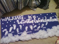 """Walking In A Winter Wonderland: Winter craft for families or a class (pictured: daycare infant class). Use blue paper or poster board & white tempera paint (washes right off little feet!). Sprinkle glitter on top of paint while wet for extra sparkle, and glue fake cotton """"snow"""" or cotton balls to the bottom! Parents loved it!"""