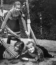 Grand Duchesses Tatiana, standing, Maria, and Anastasia play on a swing during a summer cruise in Finland in 1908. Courtesy: Beinecke Library