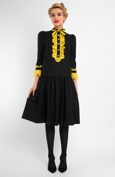 3/4 sleeve low-waist black wool dress. Band collar with a bow. Lace jabots and sleeve finish. Hidden back zip closure.