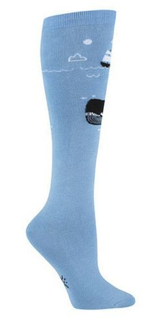 There she blows!    Blue knee high socks with a large whale swimming below a ship at sea.  Fits women's shoe size 5-10.