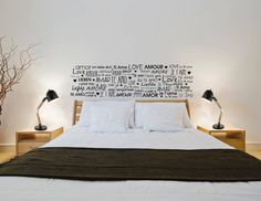 Awesome cool, conceptual bedroom with modern, chic, scandinavian style and creative fonts for bed head.  Lighting by Class Iluminación