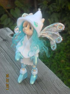tall, stands well on her own. Hand sculpted of high alto polymer clay over a strong armature. Green glass eyes faies love the sound of tiny bells so she has one at the tip of her hat. Polymer Clay Fairy, Polymer Clay Dolls, Polymer Clay Projects, Polymer Clay Creations, Clay Fairies, Baby Fairy, Clay Figurine, Fairy Art, Fairy Dolls