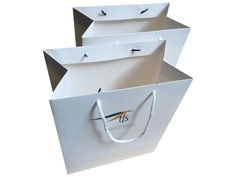 Event bag: white gloss paper bag with white rope handles an company logo printed