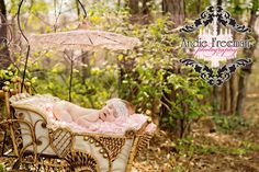 Newborn baby girl in vintage 1800s doll carriage wearing ivory lace headband. Outdoor newborn session. Andie Freeman Photography.  www.TheAthensNewbornPhotographer.com