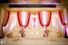 #Peach #blush #cranberry #stage for this beautiful reception #chandelier #SKES