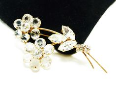 Holiday 2015 Sale - Marked Down 20% ! #GiftIdeas Happy New Year Vintage Rhinestone Flower Brooch - Clear Ice White - Long Stem Flowers offered by #TheJewelSeeker on Etsy  Style:  Long stem flower with #transparent faceted g... #vintage #jewelry #teamlove #etsyretwt #ecochic #thejewelseeker