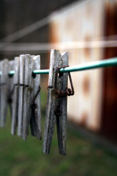 Clothespins were used to dry clothes on the line outside. Dryers were VERY expensive back then.