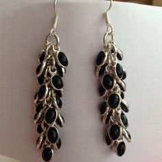 Silver overlay Onyx bezel dangle charm earrings  925 Sterling silver overlay bezel, %black Onyx , rounded on one side & flat gems on back, super sparkly ✨ charm earrings, in grape vine style w/French hook fasteners. 3 inches long. NWOT  Handmade Jewelry Earrings