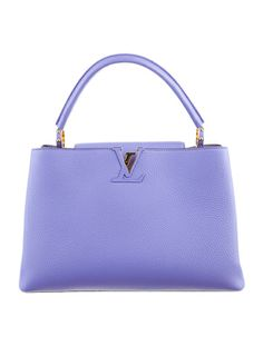 The new it bag - Louis Vuitton Capucine MM Bag. #RealRealGifts #TheRealReal