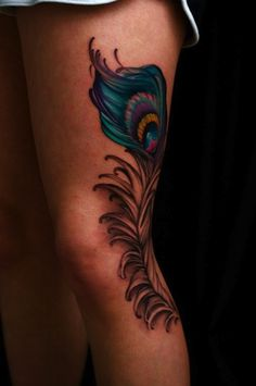 Colored and black realistic peacock feather tattoo