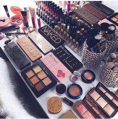 4 eyeshowdow paltes and 2 two faced chocolate bar eyeshodow blush highlight conelour lipstick lipgloss false eyelashes mascarra eyelash curler with brushes