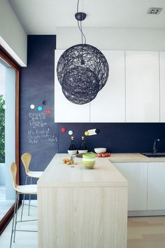 Beautiful Minimalist Interiors - I love the incorporation of wood into this kitchen and dining room.