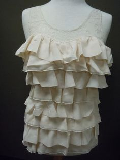 Sister Moses Cream Ruffle Top. Pair with a boyfriend jean for a cute evening outfit. $58.