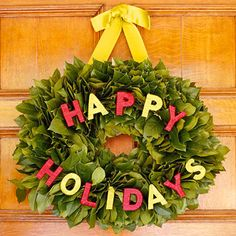 "Holiday Greetings: The letters that spell out ""Happy Holidays"" are twine-wrapped wooden cutouts; however, craft stores will have other options for your holiday message. Find more information about making this wreath in the link below."