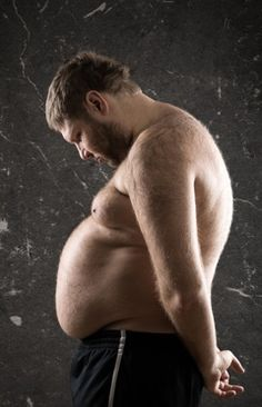 Overweight Man Looking Down at His Belly