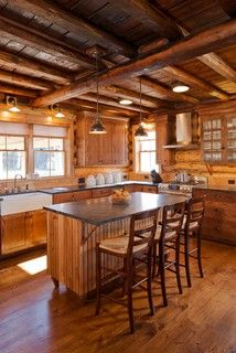 Log Homes and Cabins. View photos of gorgeous log home interiors as a source of design inspiration. Log home kitchens, bedrooms and great rooms. Log Cabin Living, Log Cabin Homes, Rustic Kitchen, Country Kitchen, Cabin Design, House Design, Log Cabin Kitchens, Cabin Lighting, Farmhouse Lighting