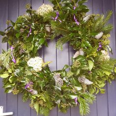 Sarah Coogan's wreath featuring hydrangeas, ...♥♥.... sprayed pinecones, pine and various pieces of foliage
