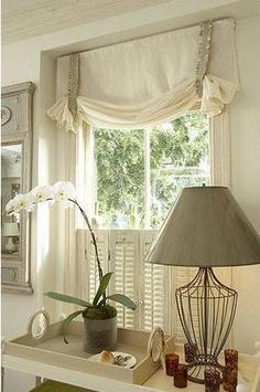 Relaxed swag with a little detail - as an idea to cover the cellular shades in your Master Bedroom.