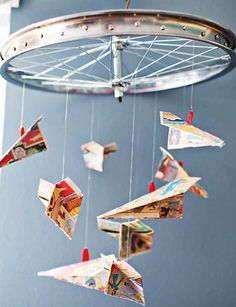 Bicycle wheel and origami butterflies made out of comic book paper! I want to do this but with cranes instead of butterflies...or BOTH!!!