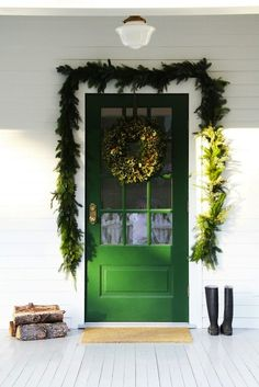 green front door dressed up for the holidays