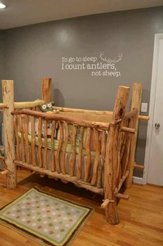 that is a very cool looking crib, the thing I love most is the saying on the wall!