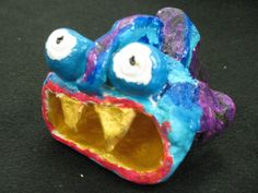 2nd grade clay fish painted with acrylic paint  Lesson by Susan Joe