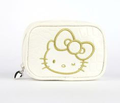 Hello Kitty Cosmetic Pouch Big Ribbon (55959-201209)- Keep ur makeup close at all times in this stylish faux patent leather cosmetic pouch. Hello Kitty's face & name appears in gold colored stitching on this white mock croc pouch & her ribbon is over-sized; special feature for this collection. Off-white patent PVC leather pouch in mock crocodile print. Polyester lining w/ bright daisy motif. 1 external pocket. Solid <3 zipper pendant. Wipe clean w/ damp cloth & air dry $19.50