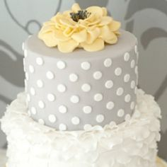 Cute grey and white wedding cake but with out that yellow flower
