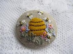 Lovely embroidered button - amazing how much can be fitted onto such a small item.