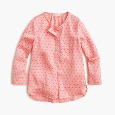 We make pink on pink look cool with a soft, drapey tunic that's covered in stars. <ul><li>Poly.</li><li>Machine wash.</li><li>Import.</li></ul>