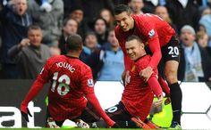 Wayne Rooney + Ashley Young + Robin van Persie , celebrate Rooney goal. Final Manchesster City 2 Vs 3 Manchester United