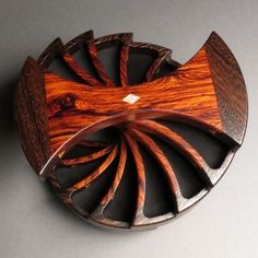 Helical rotating jewelry box by Eugene Watson. Complete with secret compartments!