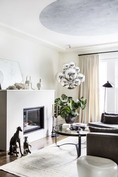 Cumberland Residence by Geremia Design. Living room with Jeff Zimmerman hanging sculpture.