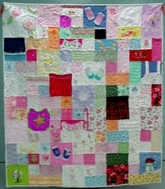 Baby clothes quilt, love this idea to cherish all those adorable clothes more!