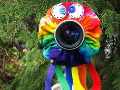 Found this on etsy. It goes on your lens to draw kids attention :D