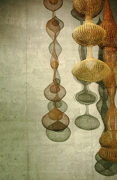 "Crocheted wire sculptures by Ruth Asawa.  ""I was interested in it because of the economy of a line, making something in space, enclosing it without blocking it out. It's still transparent. I realized that if I was going to make these forms, which interlock and interweave, it can only be done with a line because a line can go anywhere.""—Ruth Asawa"