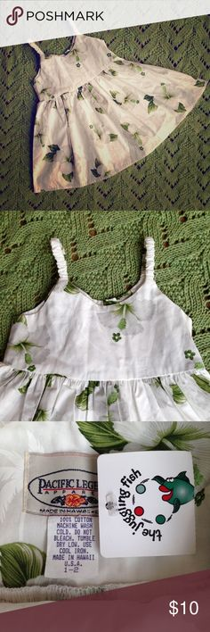 """Pacific Legends Apparel """"bungee"""" Hawaiian Sundress So sweet!  White sundress with tropical green and white flowers. Stretchy spaghetti straps. Ties in back.  100% cotton. On the clothing manufacturers website, it says size 1-2 is best for one year olds. Pacific Legends Apparel Dresses Casual"""