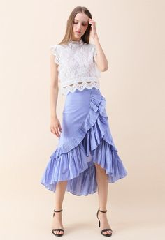 Lights, camera, fashion! Take center stage and rule the spotlight in this saucy statement skirt boasting blue stripes, ruffles, and a tiered design. - Tiered ruffles trimmed - Asymmetric hi-lo hemline - Concealed side zip closure - Lined - 65% polyester, 35% cotton - Hand wash cold Size(cm) Length Waist XS 54-91 66 S 54-91 70 M 55-92 74 L 56-93 78 Size(inch)Length Waist XS 21-35.5 ...