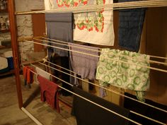 DIY a rack for line drying clothes inside - this one can handle three loads of laundry