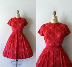 Vintage 1950s dress, red and pink check pattern in a light-weight cotton/nylon blend, fitted bodice, capped sleeves, fitted waist with attached bow