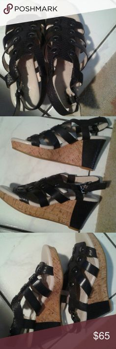 Easy spirit leather upper very cushiony wedges Easy spirit leather upper very cushiony wedges that are black and cork wedges with a cool design black top. They are size 6 and like new! Really great condition. I wore a couple times. They are sooo comfortable. Easy Spirit Shoes Wedges