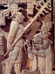 Yaxchilan, Lintel 24. Ca. 723 CE/AD.  Carved limestone relief commemorating a ritual of October 28, 709 CE/AD.  Under the glow of a flaming torch, held aloft by the Yaxchilan King, Itzamnaaj B'alam,II, Lady K'ab'al Xoc, both Aunt and wife of the king, draws a stingray-barbed rope through her tongue to induce heavy bleeding onto special papers to be burned in order to release an ancestral oracle.