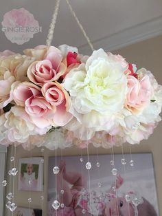 Early mobiles did not necessarily move, as do most crib mobiles today. The modern crib mobile is… Hanging Flowers, Paper Flowers, Baby Room Decor, Nursery Decor, Mobiles, Pink Mobile, Flower Mobile, Floral Chandelier, Beaded Chandelier