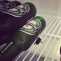 Keep your beers neatly stacked in the fridge with a binder clip. | 30 Brilliant Ways To Hack Your Booze