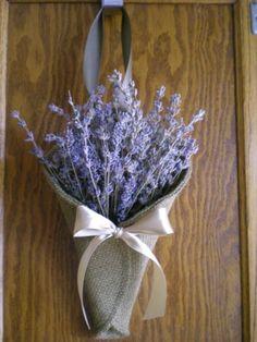 Lavender burlap pew cones / www.callaraesfloralevents.com