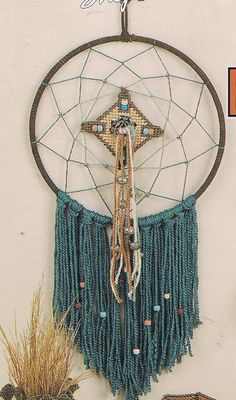 Beautiful Santa Fe Plastic canvas dream catcher is sure to inspire only great dreams. Page 1 of 2