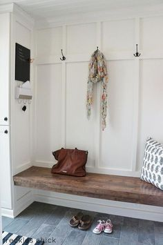 simple mudroom. Like the board. Needs cabinets underneathe